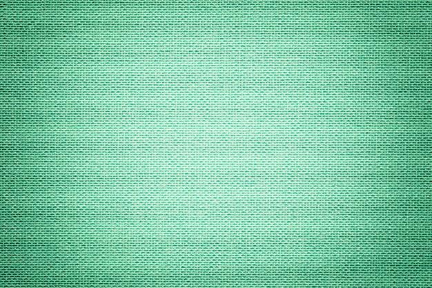 Fond vert clair d'un matériau textile avec motif en osier