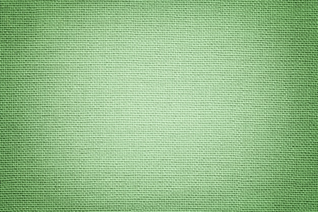 Fond vert clair d'un matériau textile.