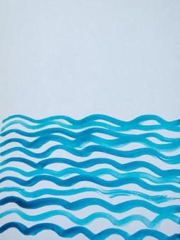 Fond vertical bleu aquarelle abstrait avec des lignes ondulées et un espace pour le texte