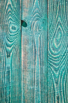 Fond vertical de trois planches texturées vertes.
