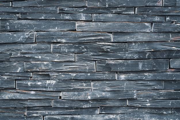 Fond d'un vieux mur de pierre noire patiné