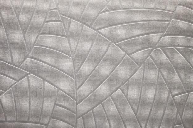 Fond de vieux papier peint beige texturé.