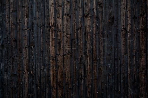 Fond vintage en bois de planche peinte en noir