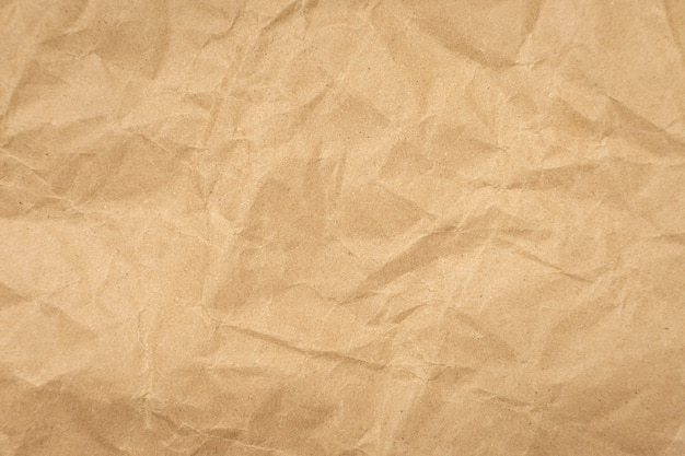 Fond vintage de texture de papier brun froissé.