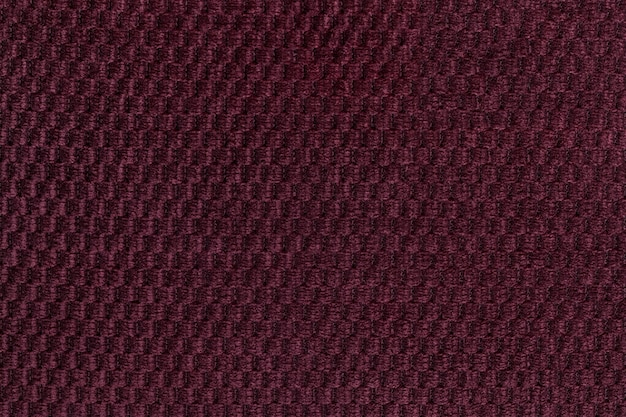 Fond violet foncé de gros plan de tissu moelleux doux. texture de macro textile