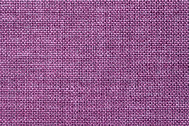 Fond violet foncé de tissu d'ensachage tissé dense, gros plan. structure de la macro textile.