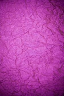 Fond violet papier texturé.