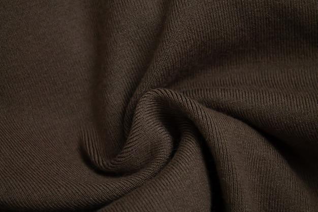 Fond de vue de dessus de pull marron tricoté en laine