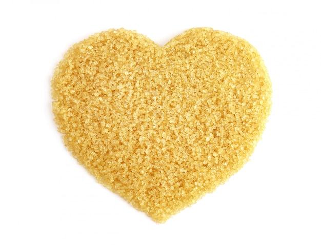 En forme de coeur de sucre de la vue de dessus de canne à sucre, sucre granulé jaune brun, sucre de saccharose, sucre rouge