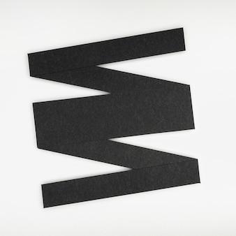 Forme linéaire géométrique abstraite noire sur fond blanc