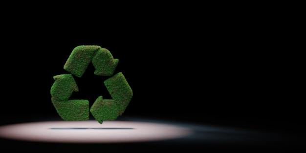 Forme de signe de recyclage d'herbe sur fond noir