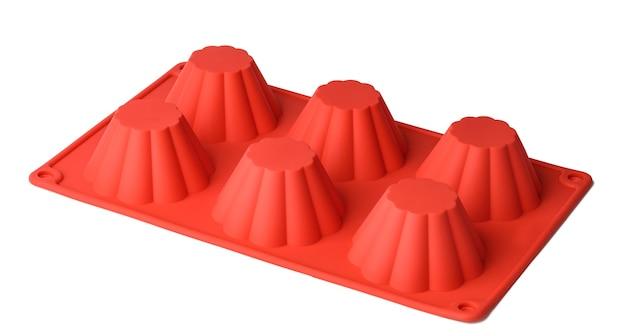 Forme de silicone pour la cuisson de petits gâteaux sur fond blanc