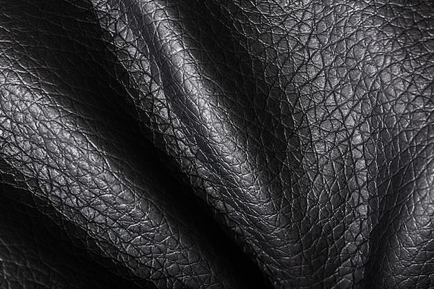Formes de vagues de texture de tissu noir foncé