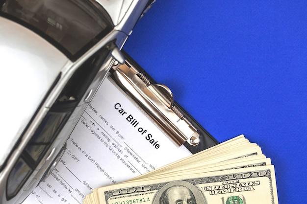 Formulaire d'acte de vente de voiture. photo vue de dessus