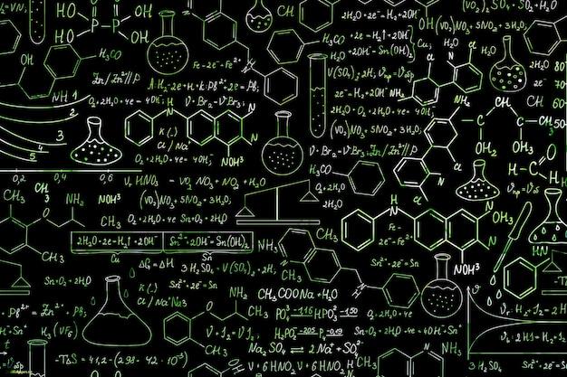 Formules scientifiques dessinées à la main sur le tableau pour le fond