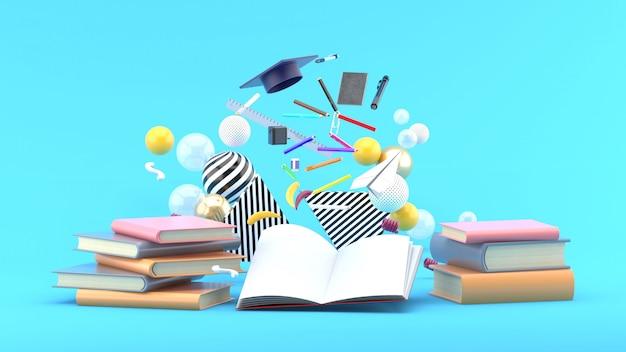 Fournitures scolaires flottant sur un livre au milieu de boules colorées sur bleu. rendu 3d