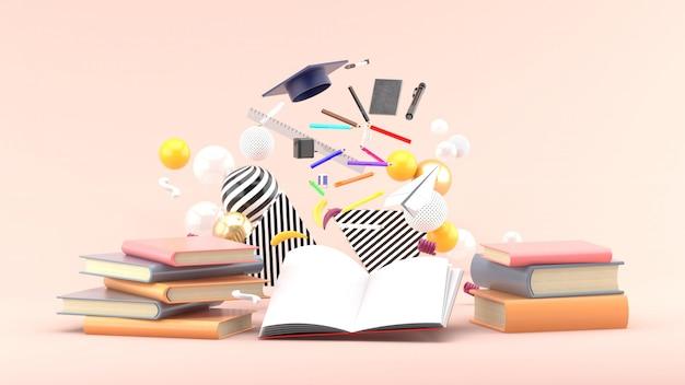 Fournitures scolaires flottant sur un livre au milieu de boules colorées sur rose tendre. rendu 3d