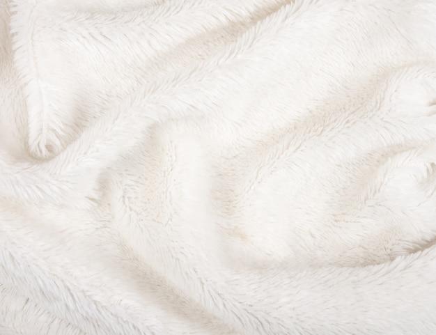 Fourrure blanche comme texture ou fond de fourrure