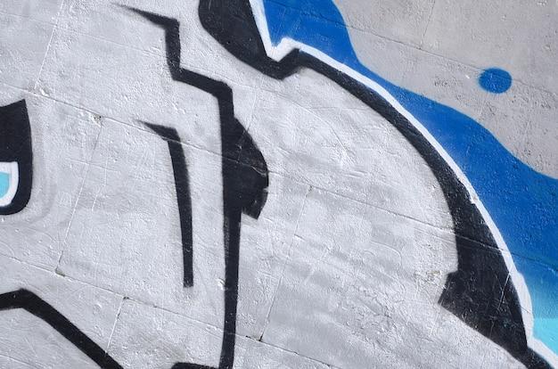 Fragment de peintures de graffiti colorées street art avec des contours et des ombres bouchent