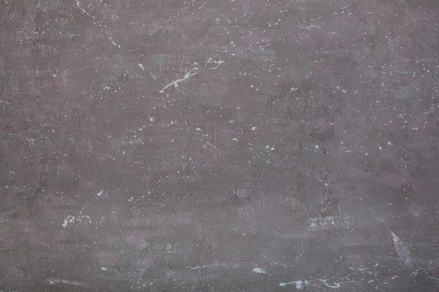 Fragment de plan rapproché de mur peint en gris dans la chambre