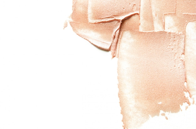 Frottis beige du surligneur ou du luminateur écrasé.