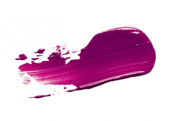 Frottis de rouge à lèvres violet isolé sur blanc