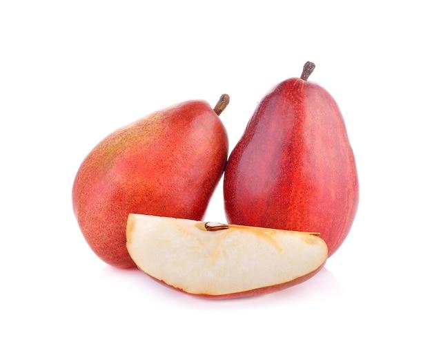 Fruits de poires rouges sur blanc