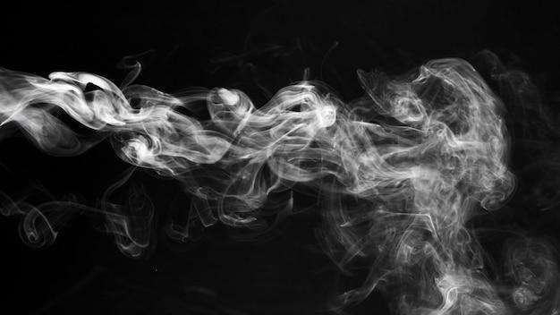 Fumée blanche texture transparente fond noir