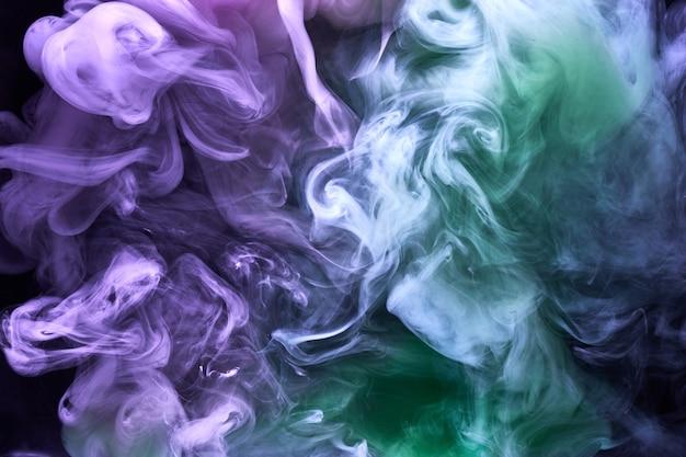 Fumée lumineuse multicolore abstrait brouillard coloré couleurs vibrantes papier peint tourbillon mélange peinture sous l'eau