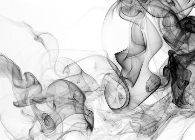 Fumée noire sur fond blanc. art abstrait. mouvement toxique
