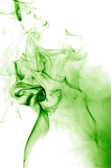 Fumée verte sur fond blanc