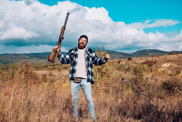 Fusils de chasse américains chasse sans frontières chasseur avec fusil de chasse sur chasse chasse en montagne