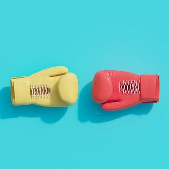 Gant de boxe rouge couleur leader concept sur bleu