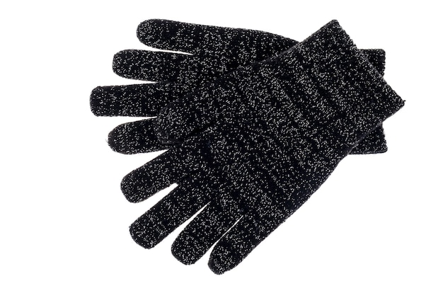 Gants de bébé en tricot noir isolés sur blanc