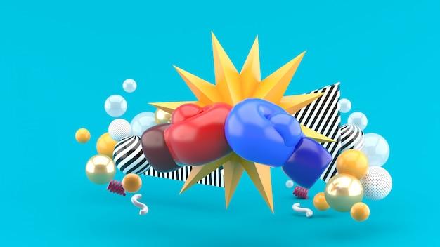 Les gants de boxe font partie des boules colorées sur le bleu. rendu 3d.