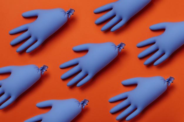 Gants médicaux bleus sur orange