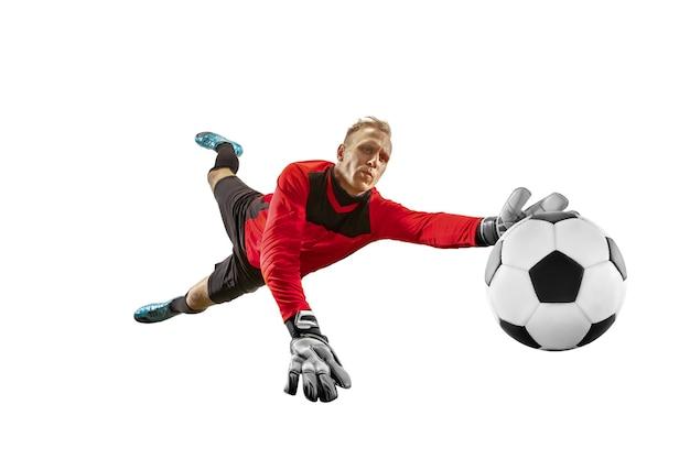Gardien De But De Joueur De Football Masculin Attraper La Balle En Saut. Silhouette D'homme En Forme Avec Ballon Isolé Sur Fond De Studio Blanc Photo Premium