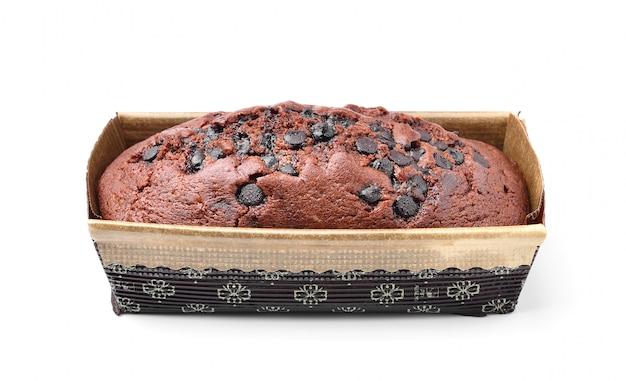 Gâteau au chocolat dans une boîte sur un espace blanc