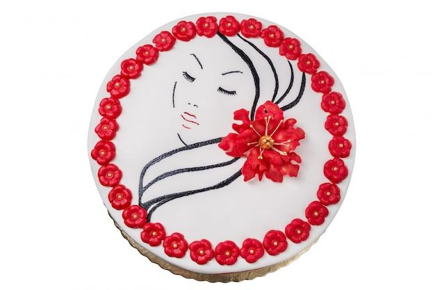 Gâteau de fleurs et un portrait d'une jeune fille. crème