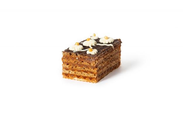 Gâteau gâteau sucré avec crème à la vanille et shkoladom.