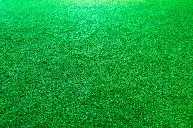 Gazon artificiel vert ou fond de texture de terrain de sport.