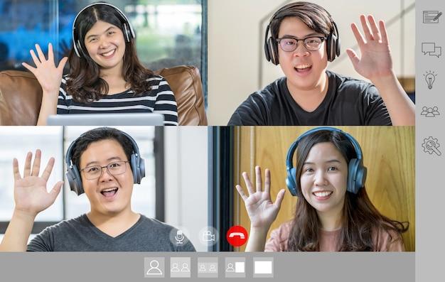 Gens d'affaires asiatiques disant bonjour avec un collègue de travail d'équipe sur un écran de conférence vidéo