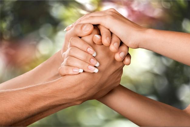 Les gens avec leurs mains ensemble. concept de travail d'équipe
