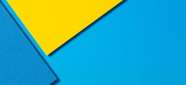 Géométrie de papiers de couleur abstraite fond de bannière de composition laïque plat avec des tons jaunes et bleus