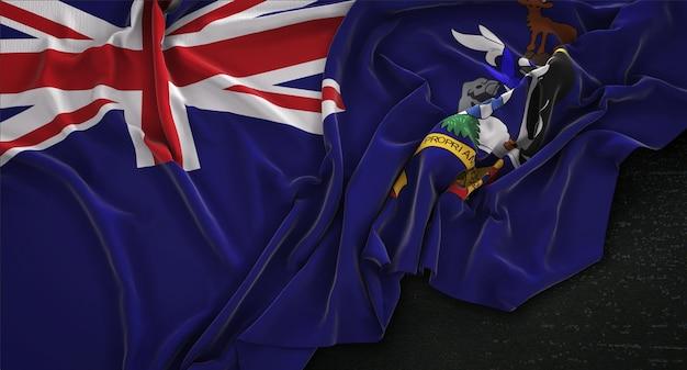 Géorgie du sud et le drapeau des îles sandwich du sud enroulé sur un fond sombre 3d render