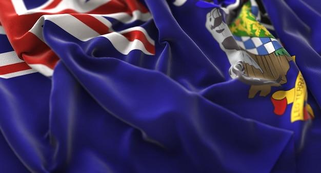 La géorgie du sud et le drapeau des îles sandwich du sud ruffled beautifully waving macro close-up shot