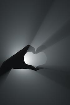 Geste de la main d'amour et de respect. faisceaux de projecteur.