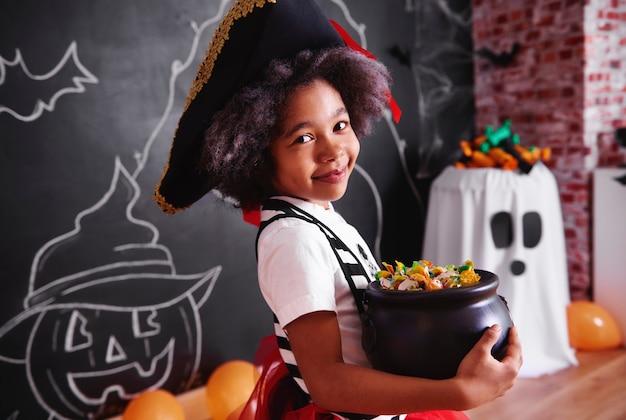Girl holding bol de bonbons