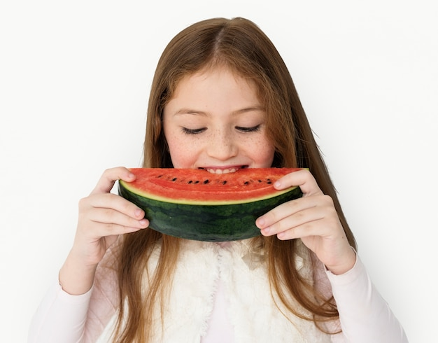 Girl mating watermelon studio concept