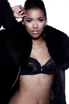 Glamour closeup portrait of beautiful sexy black young woman model with bright maquillage with perfect clean in fur coat
